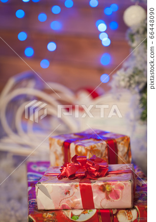 festive gifts, Christmas balls and garland lights on background. Festive New Year decoration. 66448090