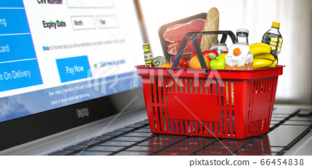Shopping basket with food and laptop with 66454838