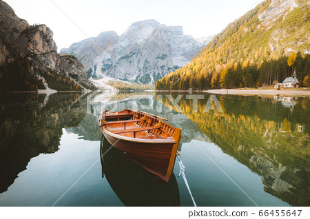 Traditional rowing boat on a lake in the Alps in fall 66455647