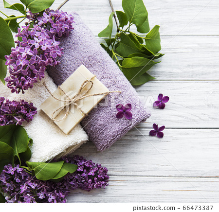 Spa towels and soap and lolac flowers 66473387