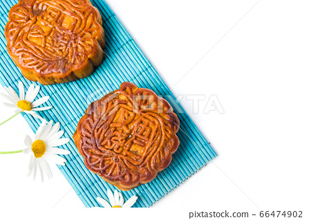 Homemade moon cake on bamboo mat and daisy on 66474902