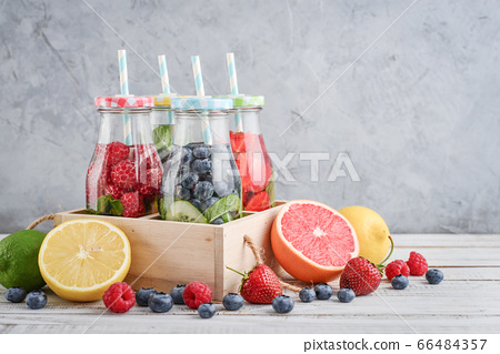 Infused water with fresh fruits 66484357