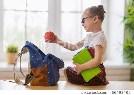 child preparing for school 66498406