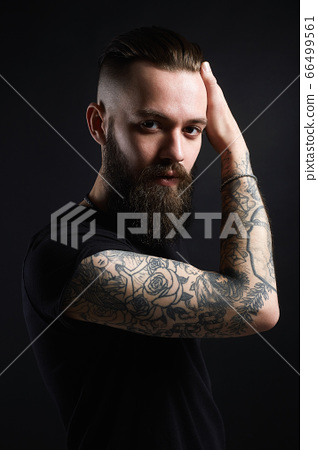 Boy with stylish haircut and tattoo. handsome Man 66499561
