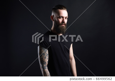 Boy with stylish haircut and tattoo. handsome Man 66499562
