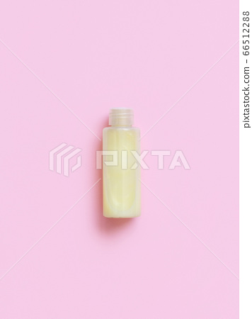 Reusable bottle with yellow liquid substance on 66512288