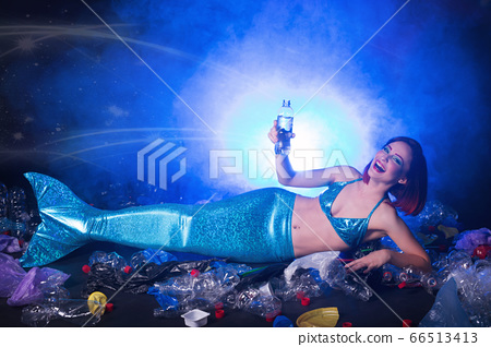Sea plastic pollution concept. Mermaid in the ocean. Plastic is everywhere. Environmental protection. 66513413