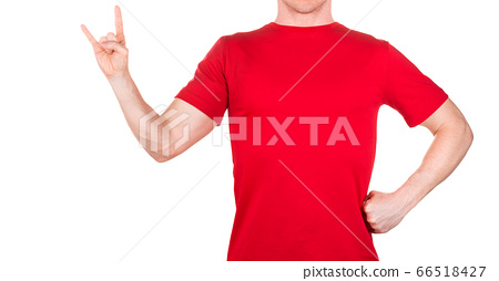 Man in red t-shirt showing rock n roll sign or giving the devil horns gesture 66518427
