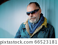Portrait of a man with glasses, mustache and beard 66523181