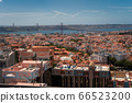 The capital of Portugal, Lisbon, top view of the orange roofs of houses, hotels and bridge 66523200