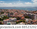 The capital of Portugal, Lisbon, top view of the orange roofs of houses, hotels, the sea coast 66523202