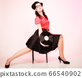 Retro music. Pinup girl with vinyl record 66540902