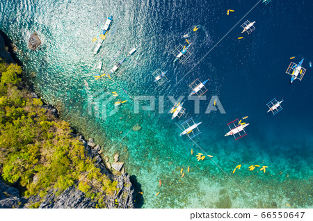 top down view of tourist boats close to big lagoon, aerial view. Tropical landscape. El Nido, Palawan, Philippines 66550647