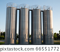 Four stainless steel silos shot in the morning sun with a clear blue sky 66551772