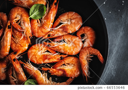 Fried shrimps with spices on pan 66553646