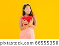 asian woman with colorful shopping bag with smart mobile phone and credit card 66555358