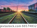 Railroad and sky with clouds at sunset with motion blur effect in summer. Industrial landscape 66574832