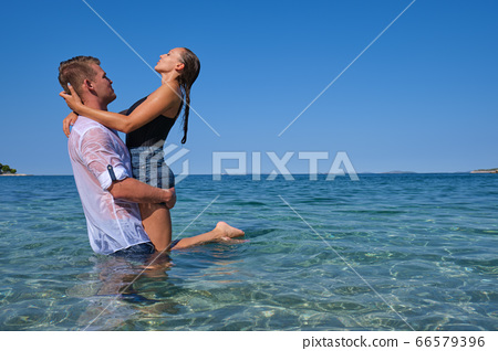 Happy couple in love on beach summer vacations. 66579396