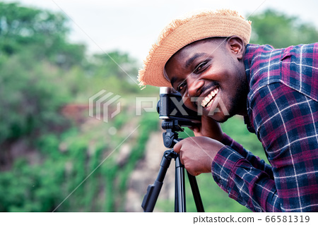 African man photograpy taking the camera and 66581319