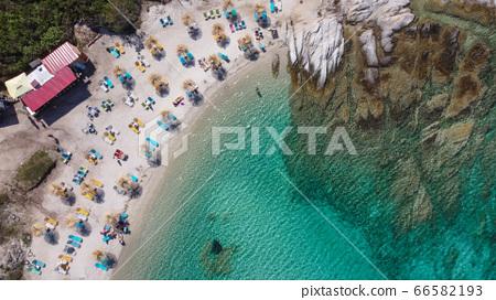 Mediterranean Greek landscape drone shot at Kavourotripes beach with bathers. 66582193