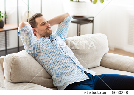 Guy having rest at home on the weekend 66602503