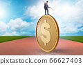 Businessman with giant golden dollar coin 66627403