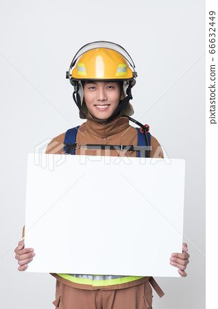 Asian male and female firefighter portrait, young smiling fireman in uniform 406 66632449