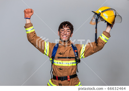 Asian male and female firefighter portrait, young smiling fireman in uniform 525 66632464