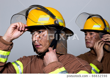 Asian male and female firefighter portrait, young smiling fireman in uniform 447 66632598