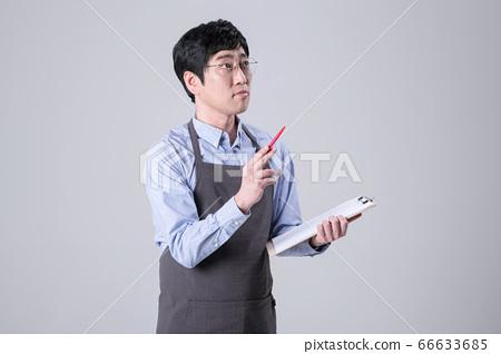 A studio portrait of Asian man making a confident smile 355 66633685