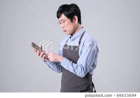A studio portrait of Asian man making a confident smile 339 66633694