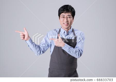 A studio portrait of Asian man making a confident smile 335 66633703
