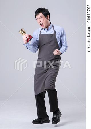 A studio portrait of Asian man making a confident smile 361 66633708