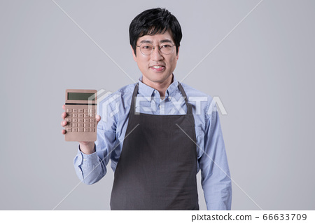 A studio portrait of Asian man making a confident smile 354 66633709