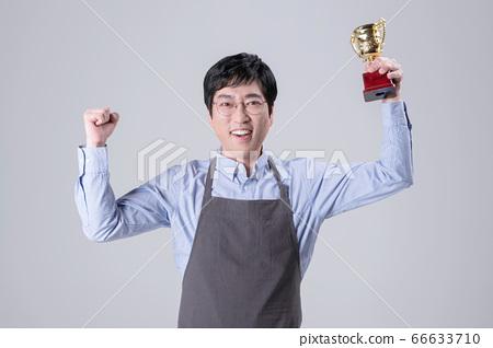 A studio portrait of Asian man making a confident smile 352 66633710