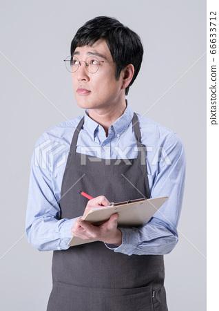 A studio portrait of Asian man making a confident smile 356 66633712