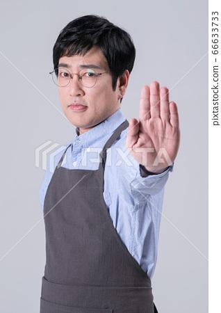 A studio portrait of Asian man making a confident smile 288 66633733