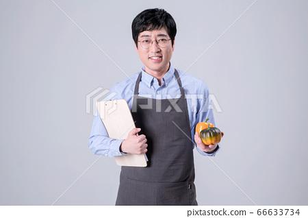 A studio portrait of Asian man making a confident smile 342 66633734