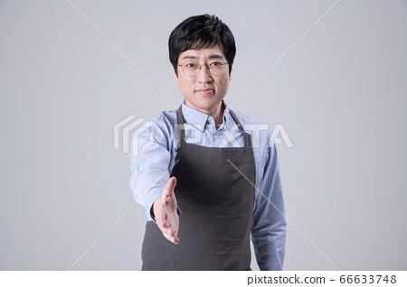 A studio portrait of Asian man making a confident smile 338 66633748