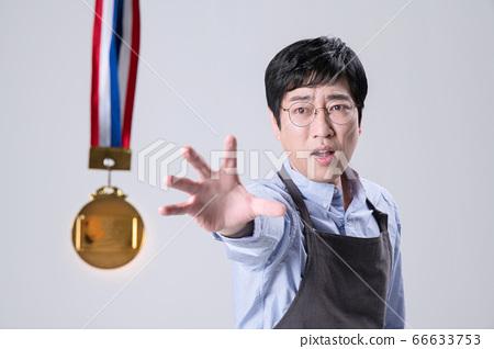 A studio portrait of Asian man making a confident smile 269 66633753