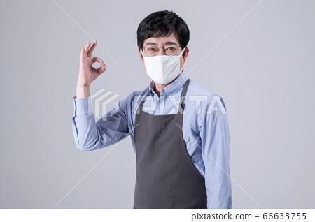 A studio portrait of Asian man making a confident smile 273 66633755