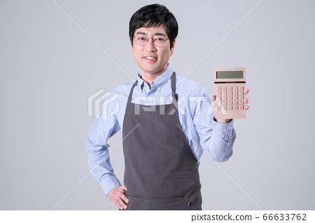 A studio portrait of Asian man making a confident smile 363 66633762