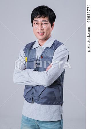 A studio portrait of Asian man making a confident smile 438 66633774