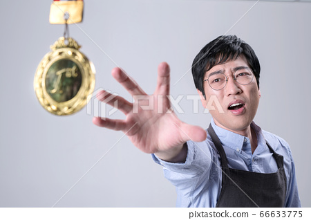 A studio portrait of Asian man making a confident smile 317 66633775