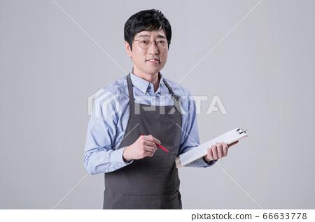 A studio portrait of Asian man making a confident smile 315 66633778