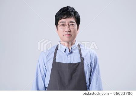 A studio portrait of Asian man making a confident smile 256 66633780