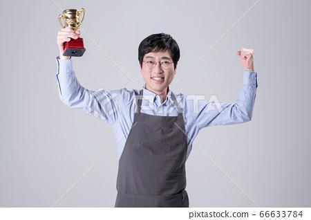 A studio portrait of Asian man making a confident smile 360 66633784