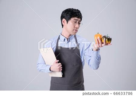 A studio portrait of Asian man making a confident smile 357 66633786