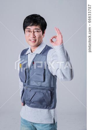 A studio portrait of Asian man making a confident smile 423 66633787