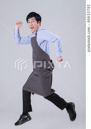 A studio portrait of Asian man making a confident smile 294 66633793